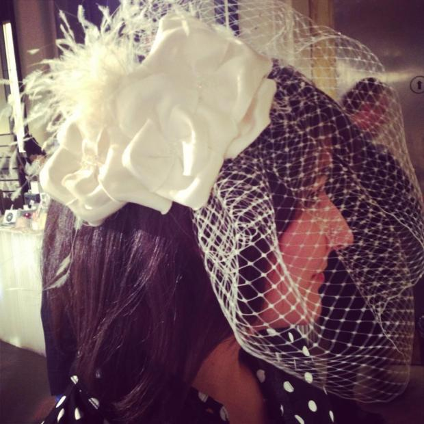 One of the KC Hats birdcage veils!